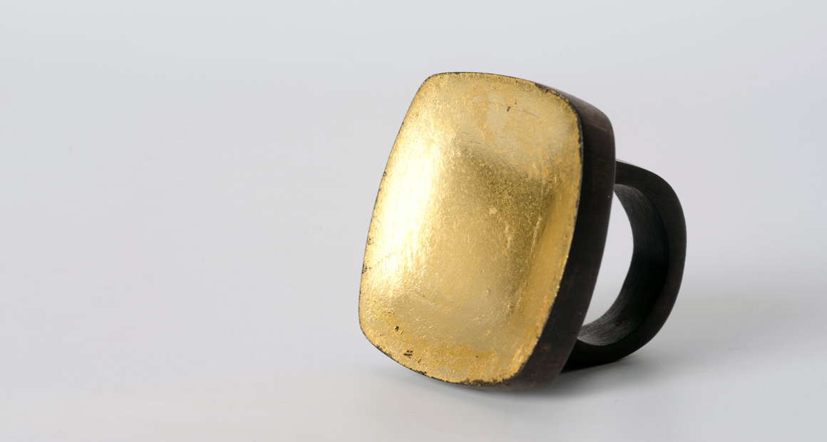 Square ebony ring with gold leaf